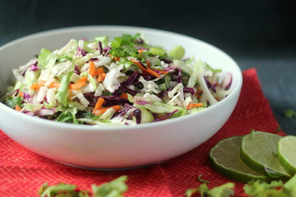 Cilantro Lime Coleslaw Recipe: A super healthy and easy side dish, perfect substitute for heavy rice or beans! #mexican #salad #vegetarian #vegan