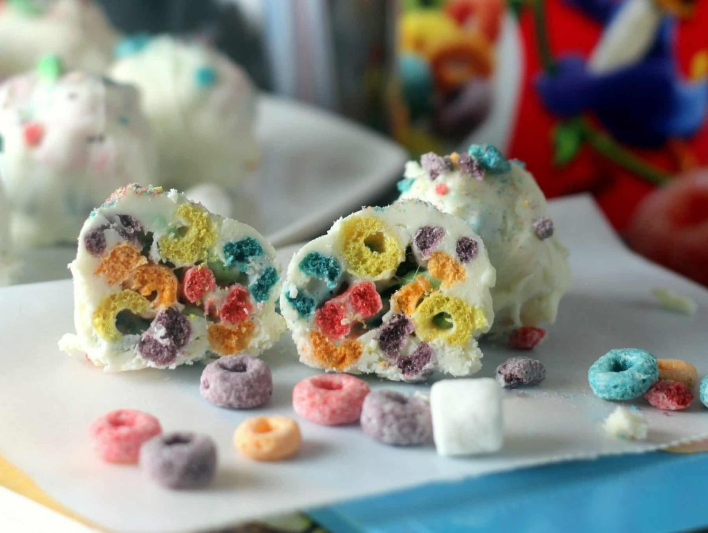 Froot Loops Marshmallow Bombs a.k.a Froot Loops Truffles! These look like cake drops on the outside, but when you bite into them they are a riot of crispy Froot Loops and melted marshmallows! #back2schoolstockup #collectivebias #dessert