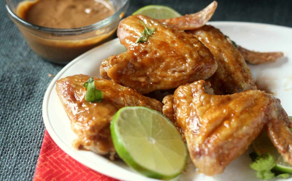 Crispy Oven Baked Asian Wings with Peanut Sauce