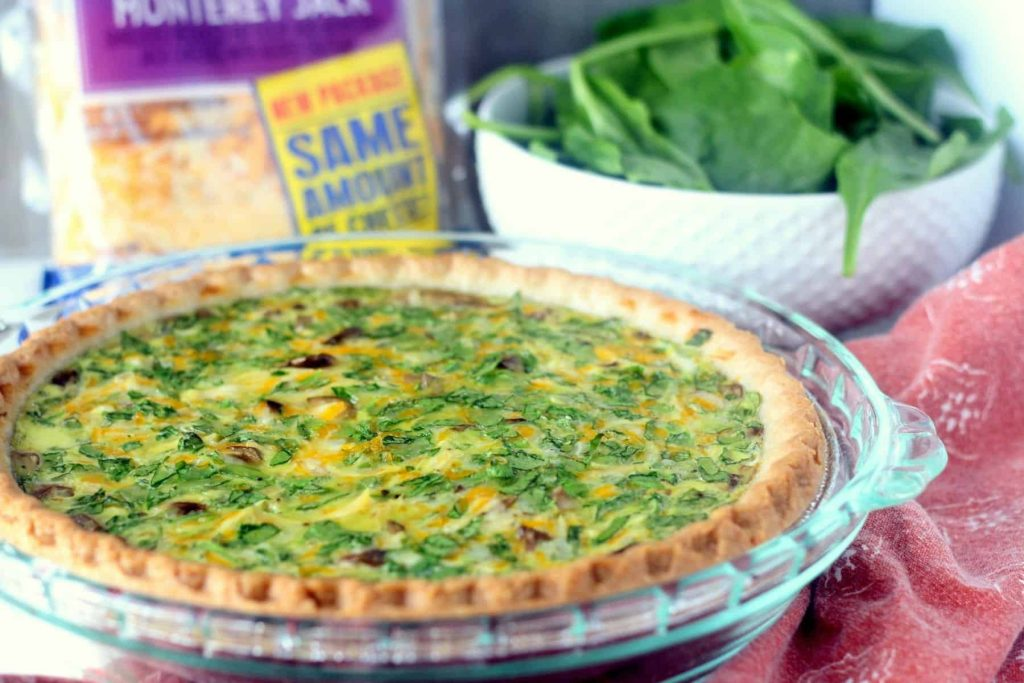 This easy and cheesy Mushroom Chicken and Spinach Quiche is the perfect MAKE AHEAD freezer meal for the busy holidays! #NaturallyCheesy #CollectiveBias ad @KraftRecipes #Cheese #Quiche #freezercooking