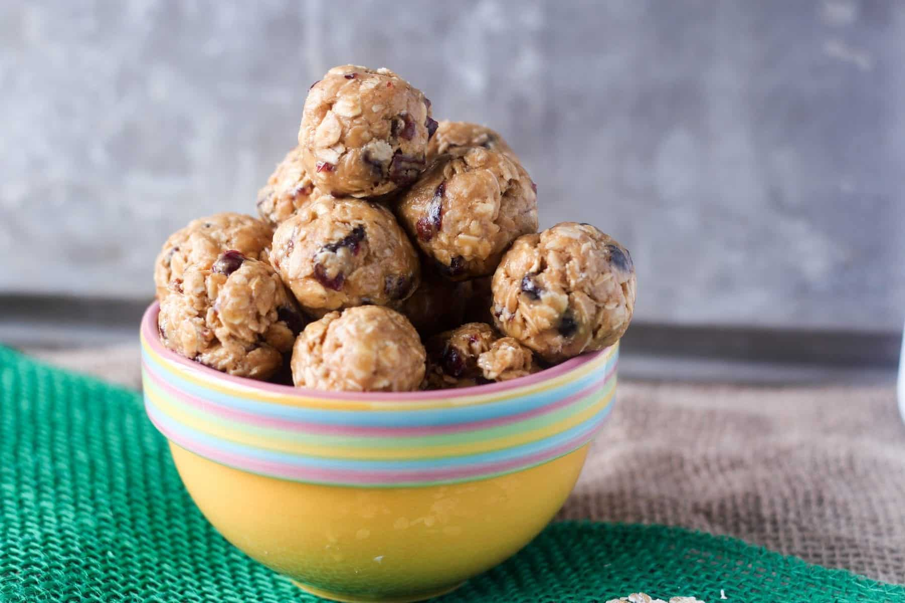 These peanut butter energy balls are high protein, incorporating peanut butter, protein powder, fruit and nuts! Honey makes these protein balls slightly sweet.