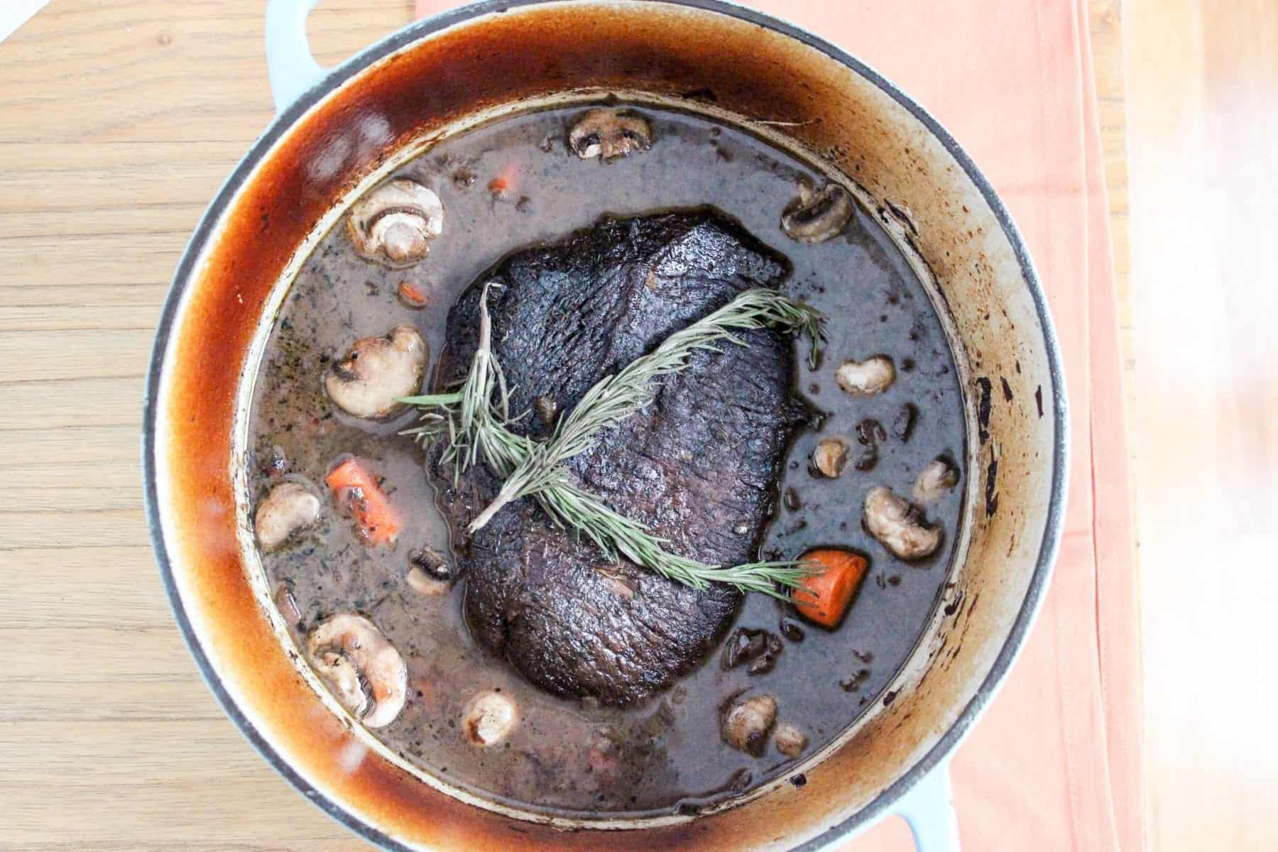 Fork tender beef pot roast with red wine, mushrooms, and root vegetables. Braised in the oven, but there's an option for the crock pot or slow cooker!