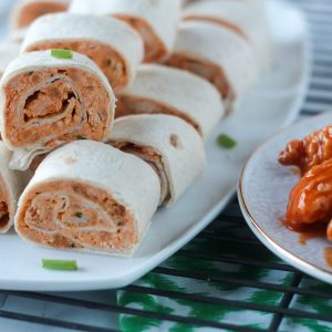 These Buffalo Chicken Tortilla Pinwheels are packed with cream cheese, cheddar cheese, buffalo sauce, diced chicken and ranch dressing. Tastes like hot wings!
