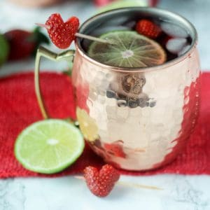 Strawberry Moscow Mules are a super easy way to mix up traditional moscow mules! Serve in a frosty copper mug for the perfect cocktail!
