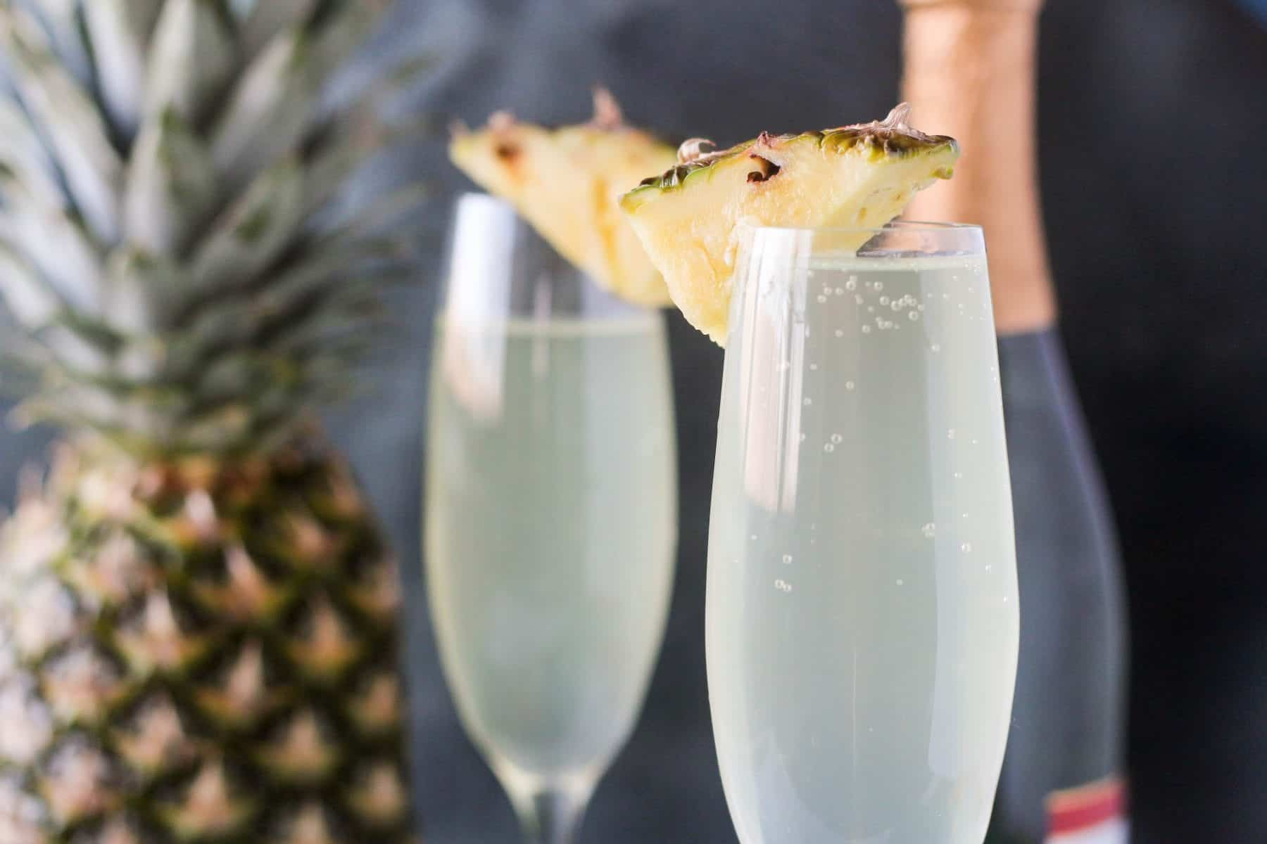 Pineapple Mimosas made with three easy ingredients!