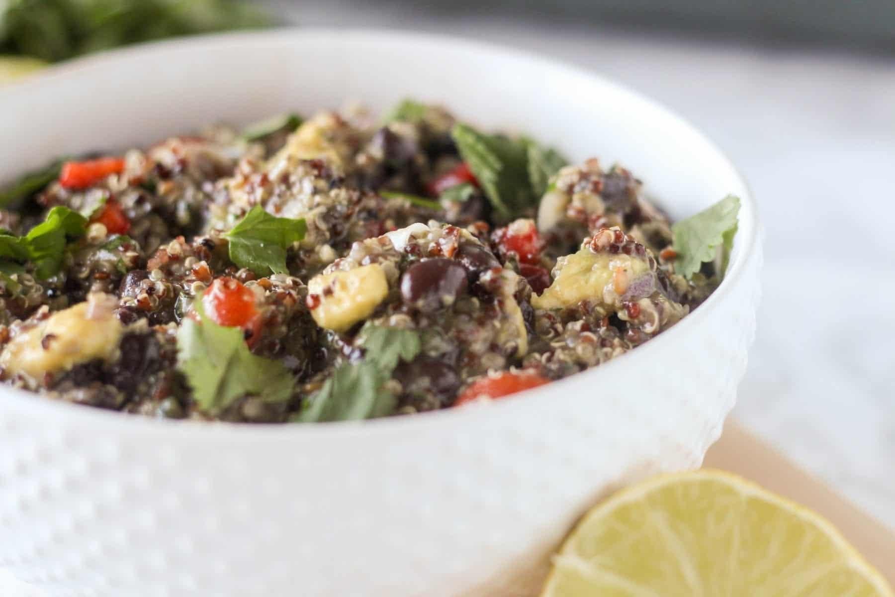 This Southwest Black Bean and Avocado Quinoa Salad combines quinoa, black beans, tomatoes, red onions, avocado and cilantro with a zesty three-ingredient lime dressing. Serve it warm or chilled. This one is great as a healthy side dish for barbecues!